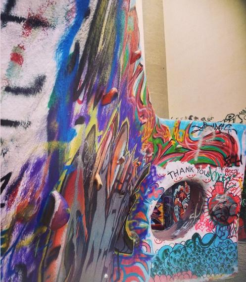 A rock wall with graffiti